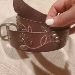 Fossil leather belt with floral grommets
